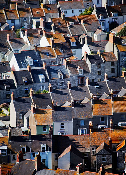 Multiple houses roofs top view stock photo