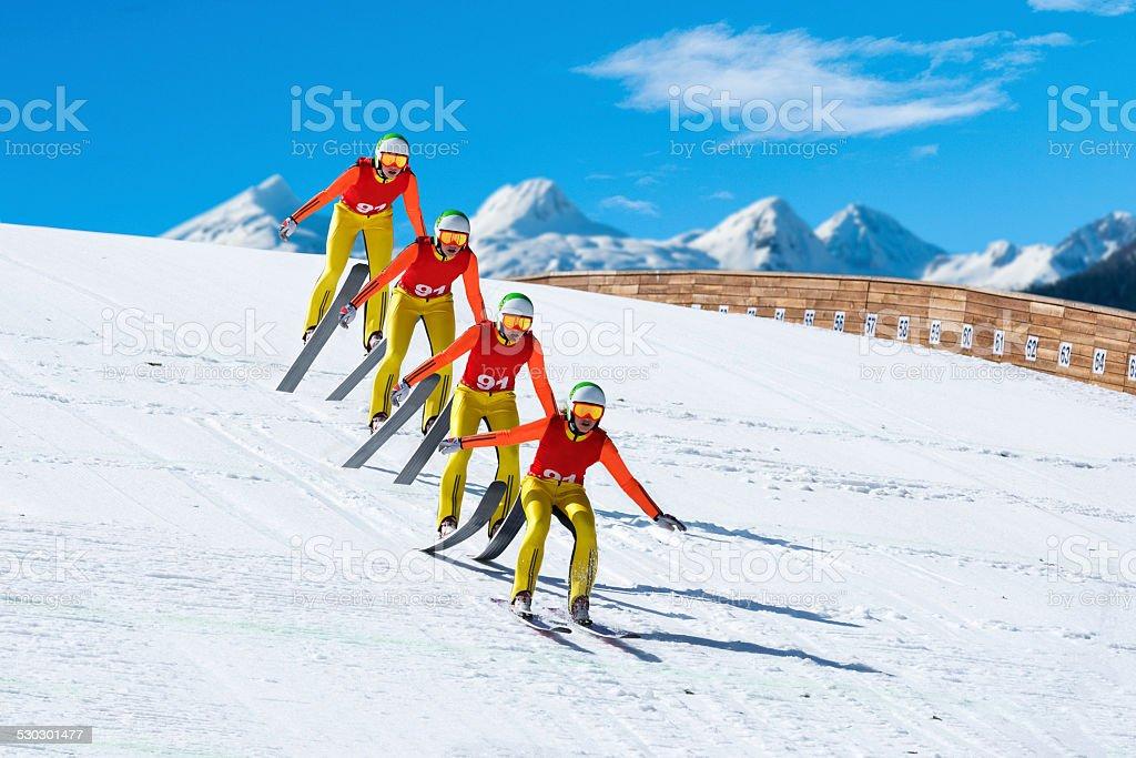 Multiple image of ski jumper landing stock photo