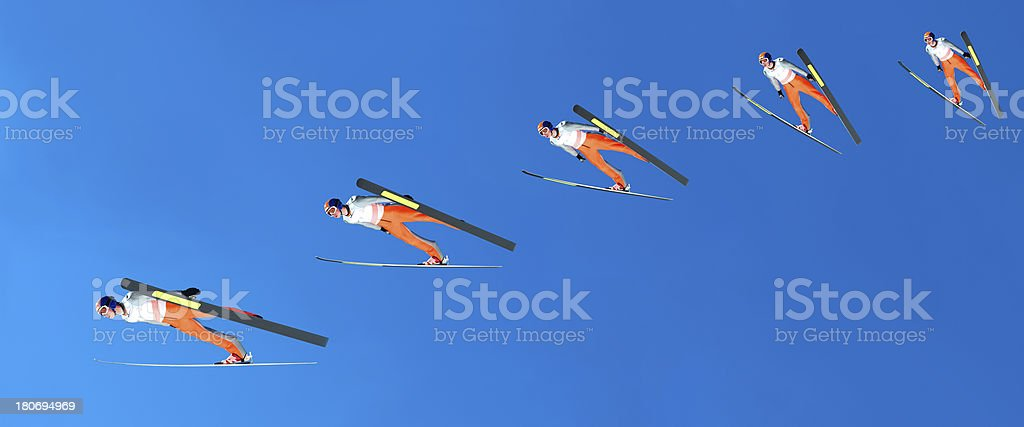 Multiple image of ski jumper stock photo