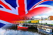 Multiple image of UK flag and fishing boats for use with articles relating to BREXIT and the EU/UK trade deal.