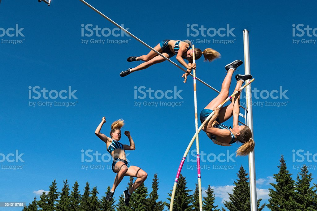 Multiple Image of  Young Women Performing Pole Vault stock photo