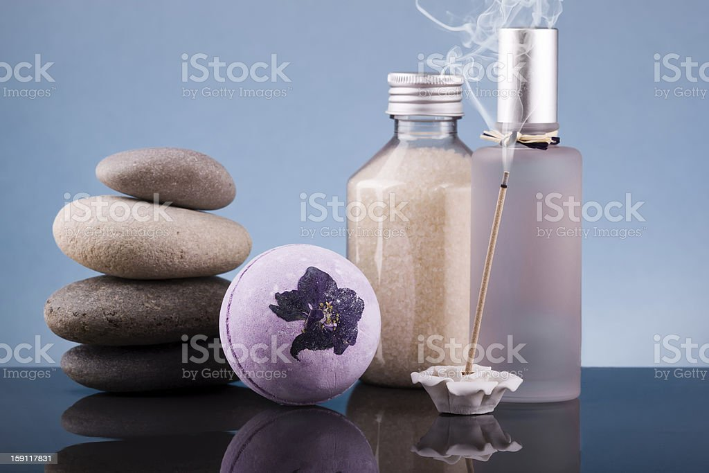 multiple items from spa beside a lit incense stick royalty-free stock photo