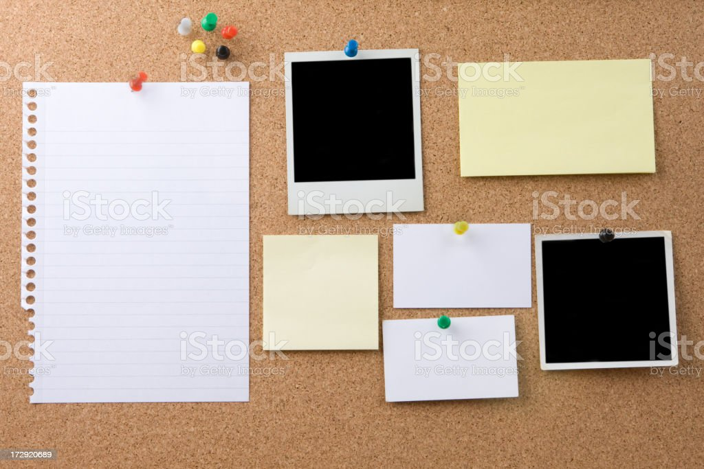 Multiple Items on a Cork Message Board stock photo