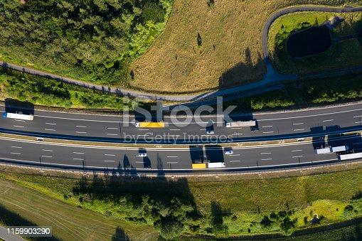 Aerial view of multiple lane rural highway with semi trucks.