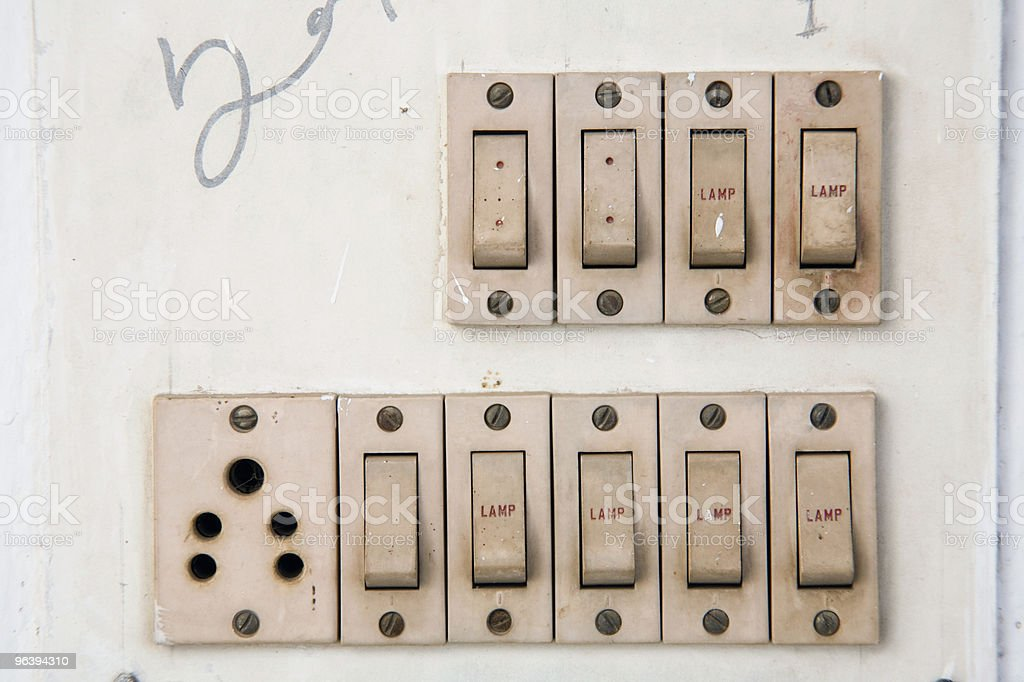 Multiple Light Switches and Electrical Outlet - Royalty-free Color Image Stock Photo