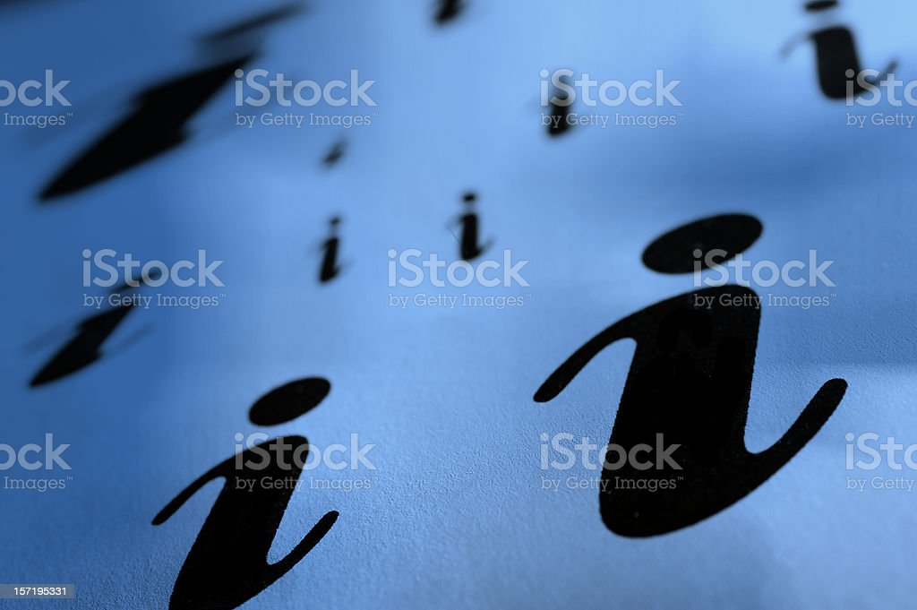 Multiple lowercase i's of various size on a blue background stock photo