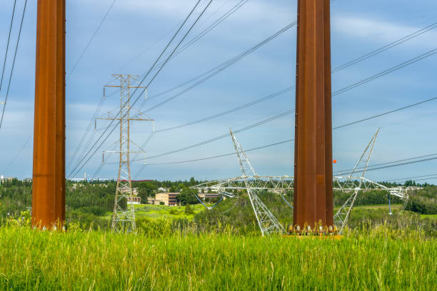 Multiple powerlines  and city stock photo