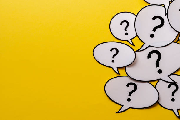 Multiple question marks in speech bubbles stock photo