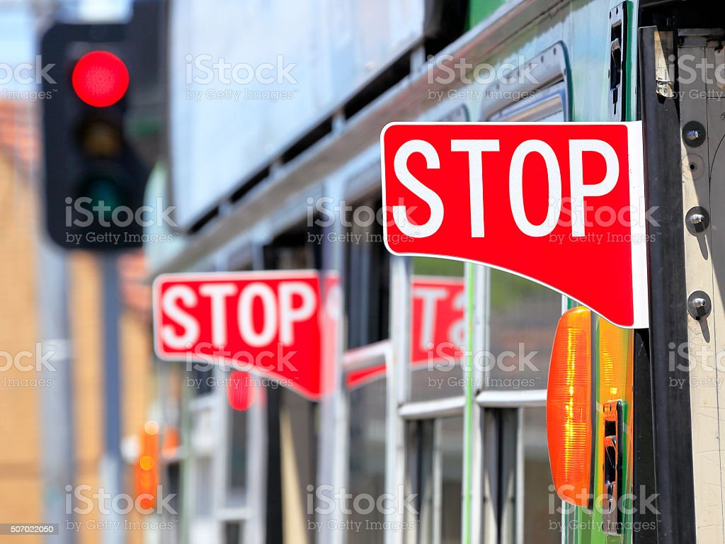 Multiple red stop signs and warning indicators on Melbourne tram stock photo