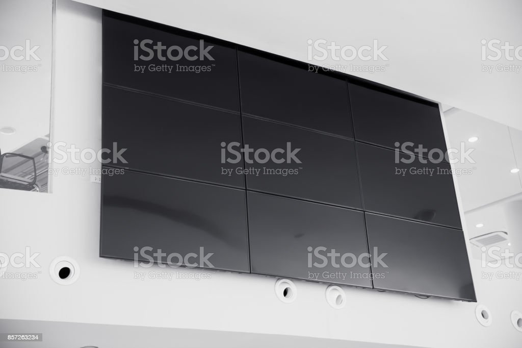 multiple screen LCD panel display in modern building office wall with clipping path at screen stock photo