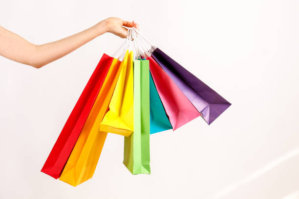 multiple shopping bags of different color in female model's hand. - tote bag imagens e fotografias de stock