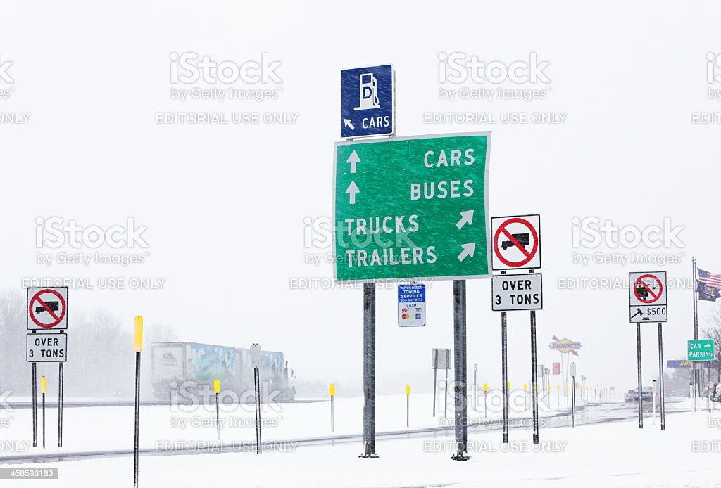 Multiple Signs at Thruway Rest Stop in Winter Blizzard stock photo