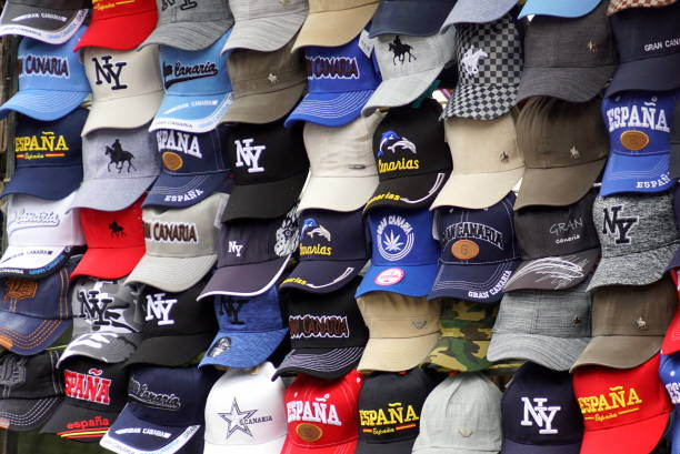 Multiple souvenir baseball caps. stock photo