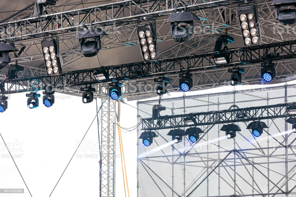 outdoor concert stage. multiple spotlights and lightning equipment...