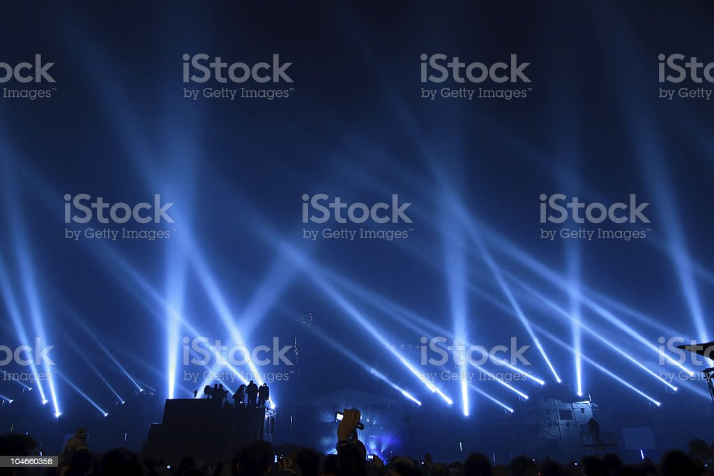 Multiple spotlights with beams of light pointing upward stock photo