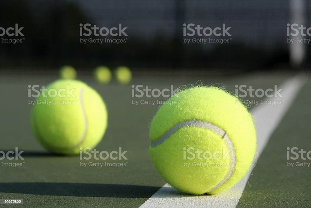 Multiple Tennis balls on the Court royalty-free stock photo
