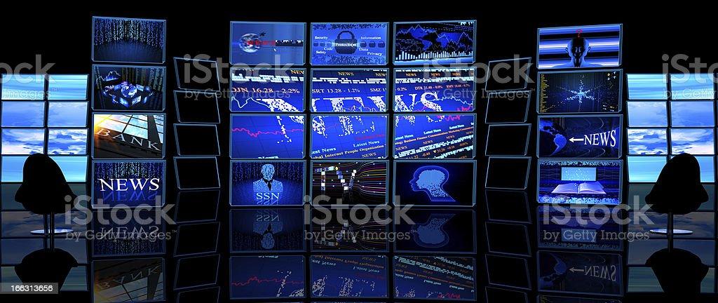Multiple TV screens display news in a dark studio stock photo