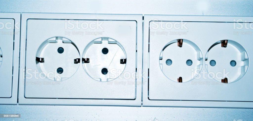 Multiple White Electric Socket stock photo