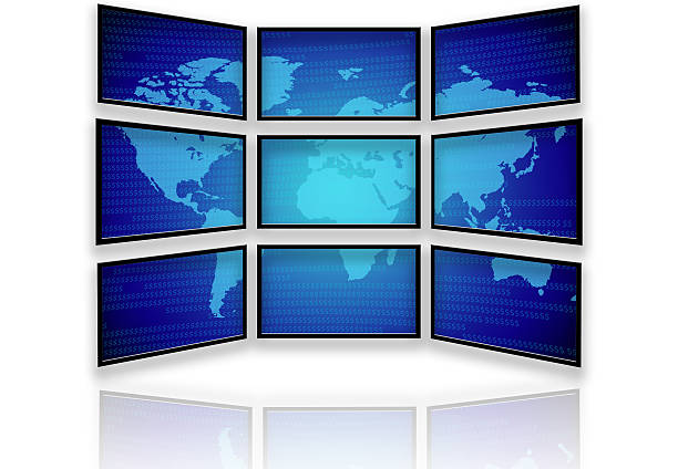 Multiple Wide screen Monitors and the World stock photo