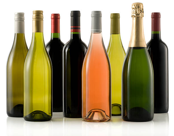 Multiple wine and champagne bottles stock photo