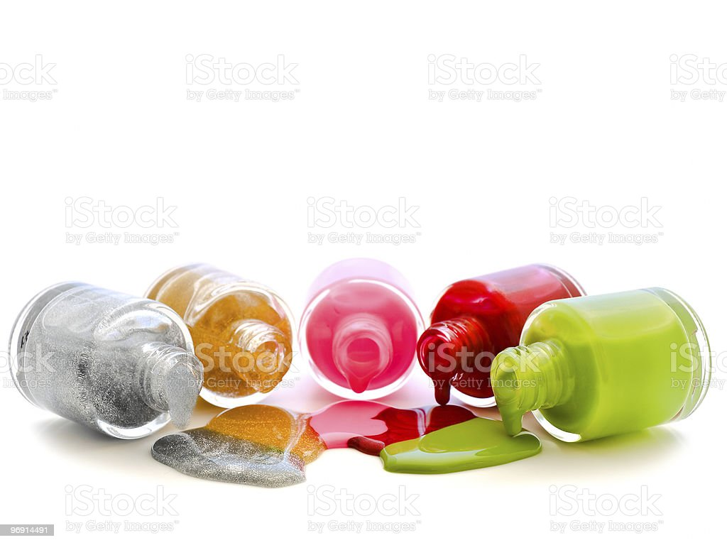 Multiples multicolored shades of nail polish spilling out royalty-free stock photo