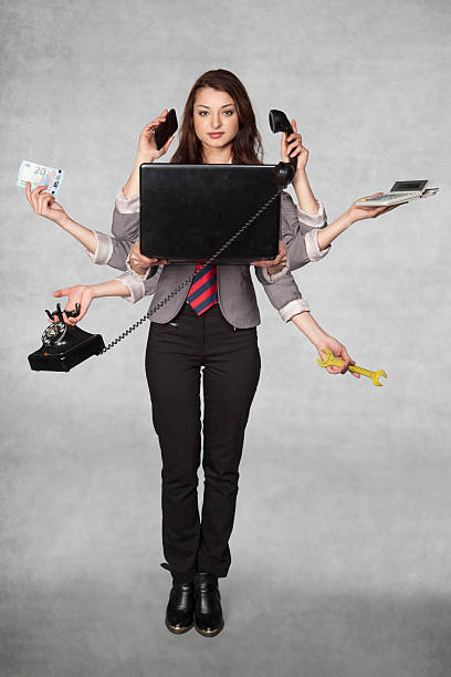 multipurpose business woman on the grey background stock photo