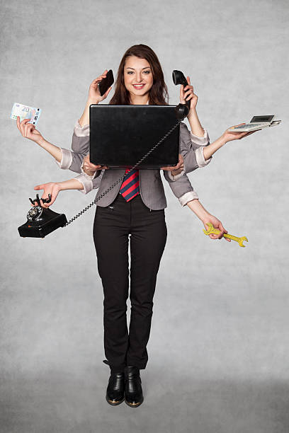 multipurpose business woman on the grey background multipurpose business woman on the grey background octopus photos stock pictures, royalty-free photos & images