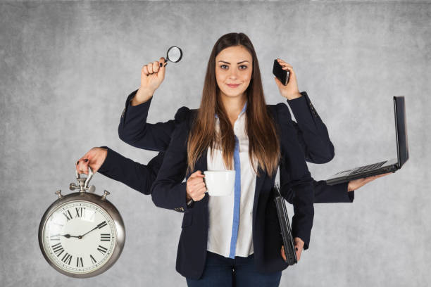 multi-purpose business woman with a large number of hands - efficiency stock photos and pictures