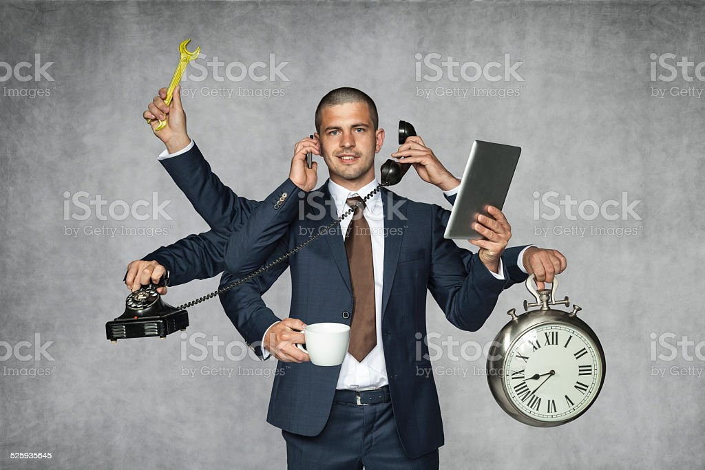 multipurpose businessman stock photo