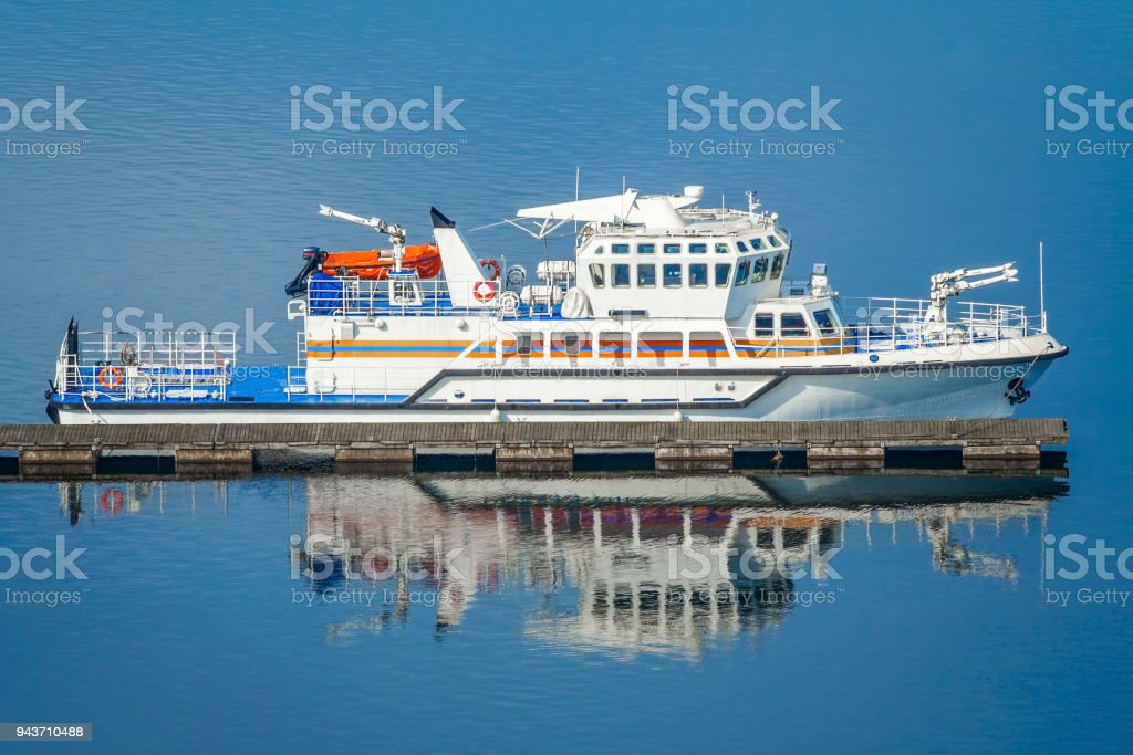 Multipurpose rescue ship on the dock on a background of blue water stock photo
