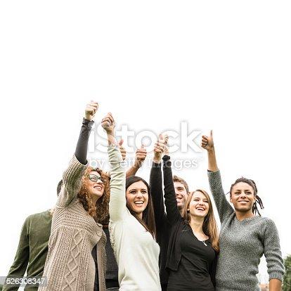 istock Multiracial adult - thumbs up 526308347