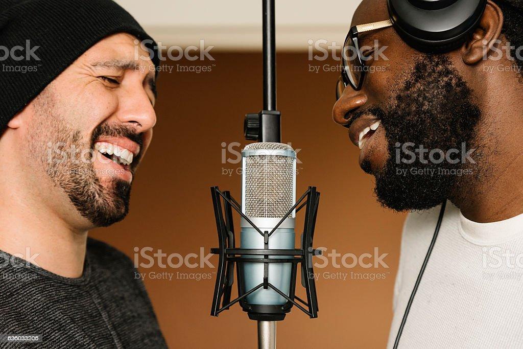 Multiracial artists singing on studio. stock photo