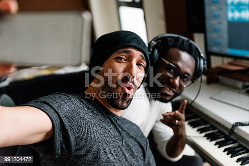 istock Multiracial artists taking a selfie. 991204472