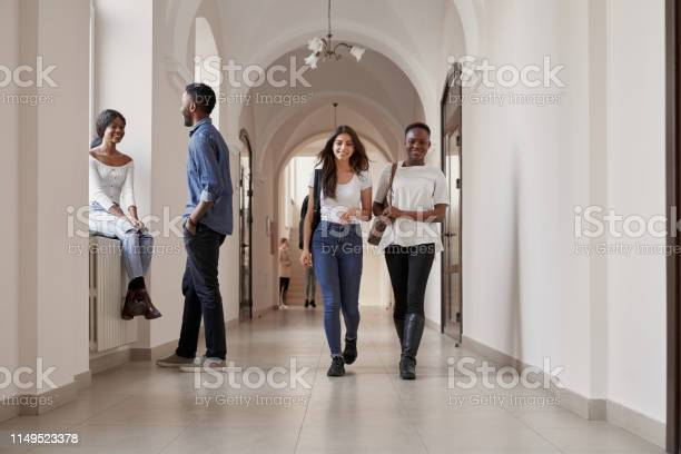Multiracial beautiful happy students casual dressed walking in hall picture id1149523378?b=1&k=6&m=1149523378&s=612x612&h=gd3ebbr8elhxkrwepsupoz hk1y vnioejvdxyffsfo=