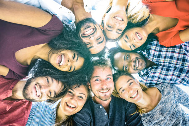 multiracial best friends millennials taking selfie outdoors with back lighting - happy youth friendship concept against racism with international young people having fun together - azure filter tone - party social event stock pictures, royalty-free photos & images