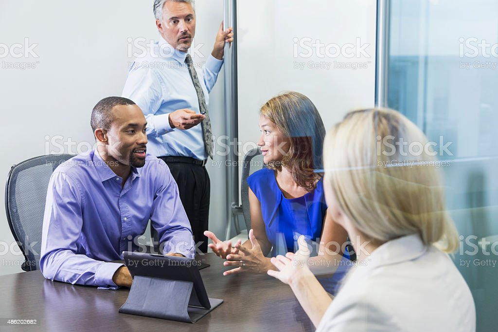Multiracial business meeting in boardroom stock photo