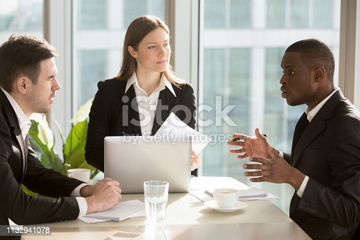 istock Multiracial business people working together planning project and business strategy 1132941078