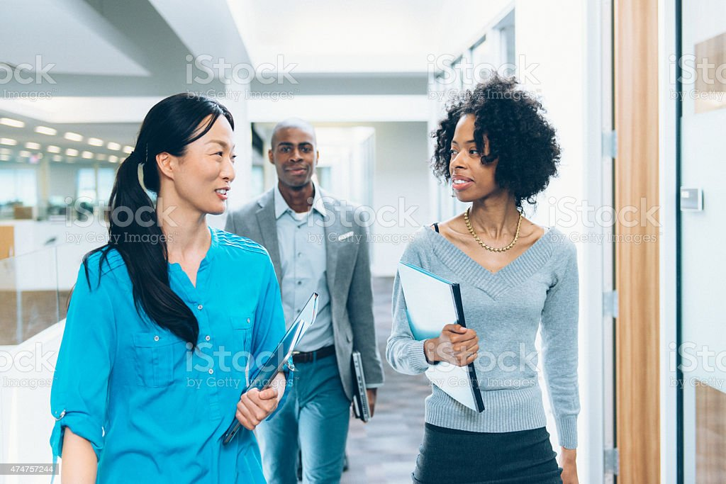 Multiracial Business Team Going to a Meeting stock photo