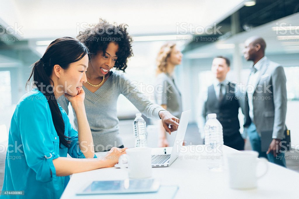Multiracial Business Woman Collaborating at Work stock photo