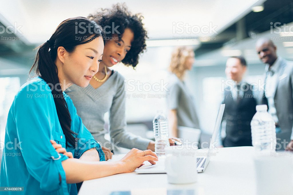 Multiracial Business Woman in a Meeting stock photo