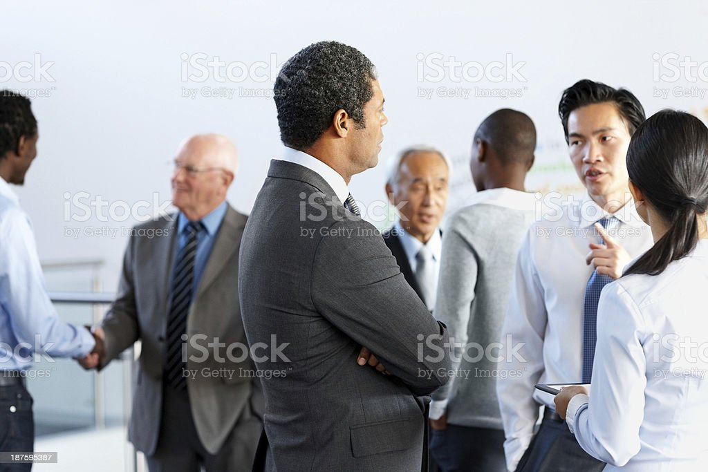 Multiracial businesspeople discussing at office stock photo
