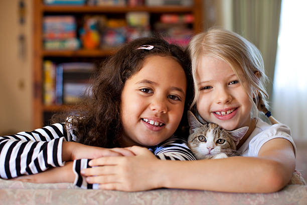 Multiracial children indoors with pet kitten cat picture id182746713?b=1&k=6&m=182746713&s=612x612&w=0&h=zk9z1foiu2iryo7oa dby7qaynaoz860zpe4caxli6w=