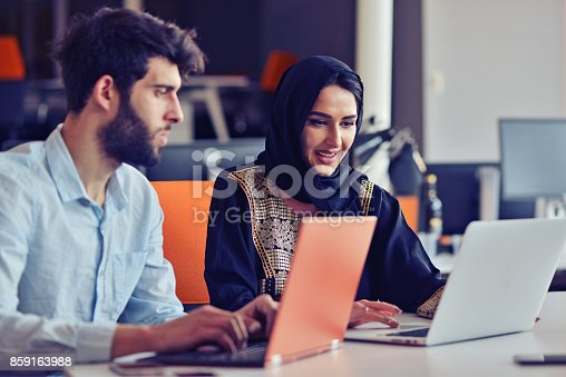 istock Multiracial contemporary business people working connected with technological devices like tablet and laptop 859163988