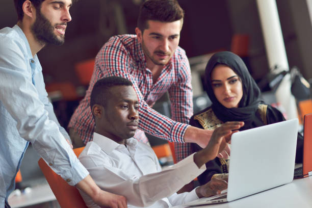 multiracial contemporary business people working connected with technological devices like tablet and laptop - arab zdjęcia i obrazy z banku zdjęć