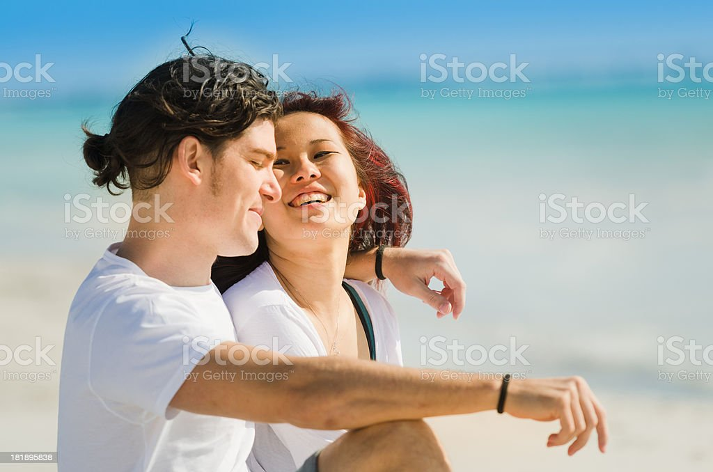 multiracial couple enjoying at seaside royalty-free stock photo