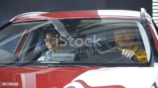 862201618 istock photo Multiracial couple exploring car in shop 957786456