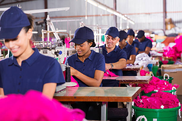 multiracial factory workers sewing stock photo