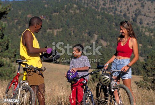 istock Multi-Racial Family Biking 137852384