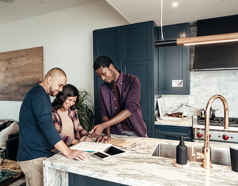 istock Multiracial family getting home consultation 1094331318
