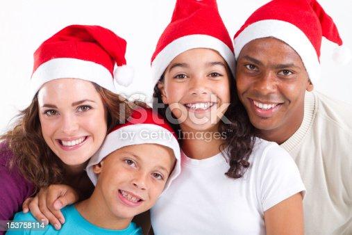 1126155137 istock photo multiracial family wearing Christmas hats 153758114